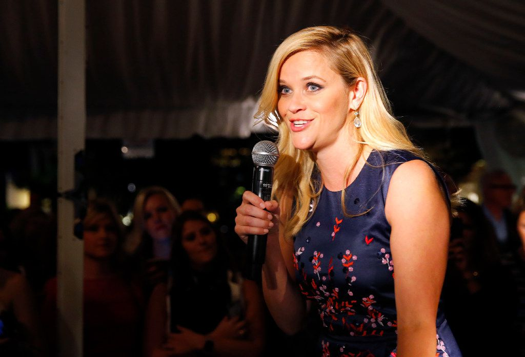 Oscar-winning actress Reese Witherspoon welcomes admirers to the grand opening of her Draper James store in Highland Park Village in Dallas.