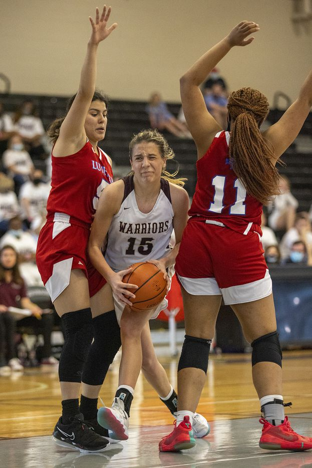 McKinney Cornerstone's Addison Schmitt (15) feels the squeeze between Houston Lutheran High North defenders Andrea Ramirez, left, and Kaitlin Alexander (11) during the TAPPS 3A girls championship at College Station High School on Saturday, March 13, 2021. McKinney Cornerstone lost, 62-34. Michael Miller/Special Contributor