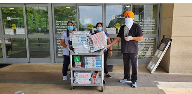 The Eknoor Gurdwara Sikh temple delivered pizzas to health care workers at Parkland Hospital in Dallas.
