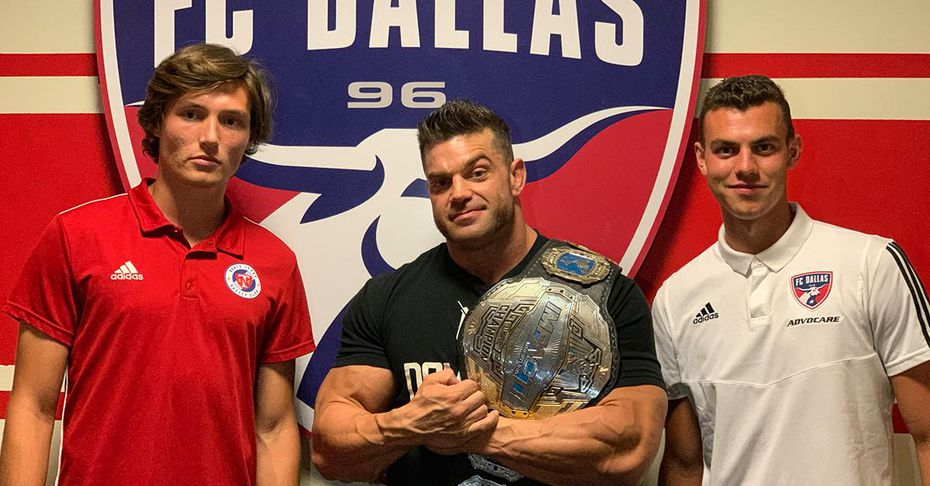 Brecc Evans (left) with Impact Wrestling's Brian Cage and FCD's Callum Montgomery (right).