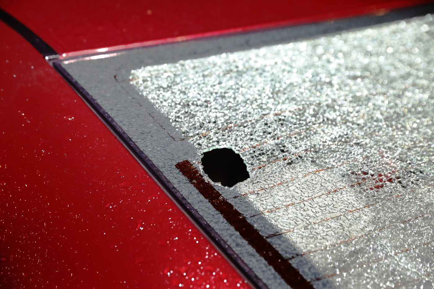 A vehicle's rear window was left shattered by hail on Meadow ridge Dr. in Prosper after a severe storm swept through the area on Friday April 21, 2017.