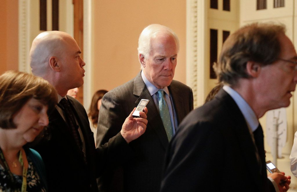 Senate Majority Whip John Cornyn of Texas was pursued by members of the media as he walked the hallway on Capitol Hill in Washington on Thursday.  It's Cornyn's job to line up Republican votes.
