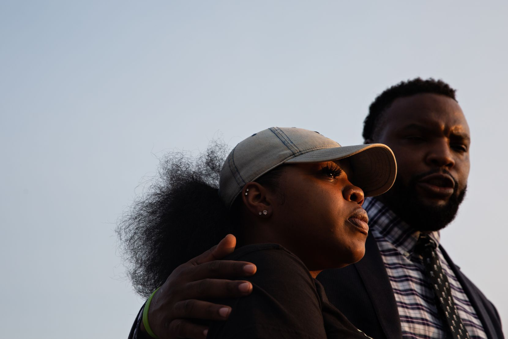 LaChay Batts and her family's attorney Lee Merritt speak to the media outside the Collin County Courthouse on Tuesday.