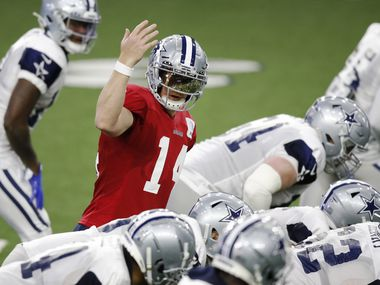 FILE - Cowboys quarterback Andy Dalton (14) signals to a teammate before the snap during training camp at The Star in Frisco on Thursday, Aug. 27, 2020.