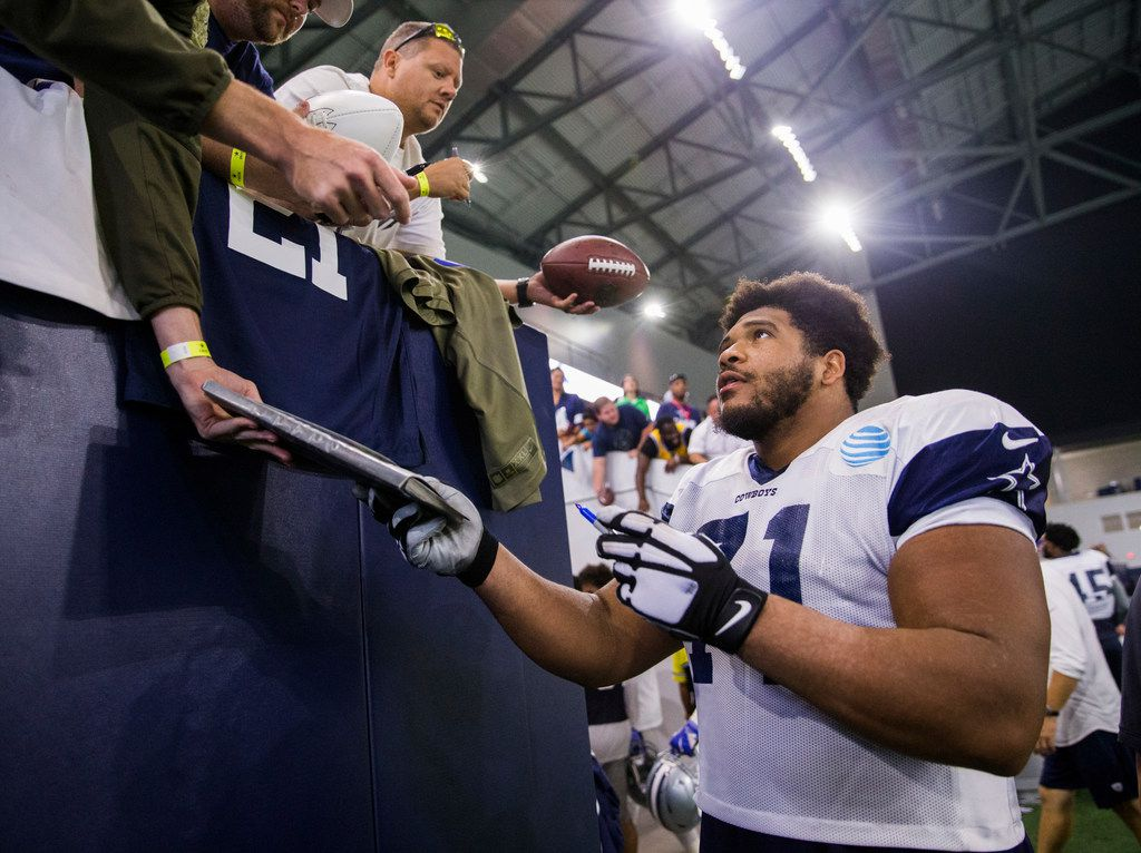 FILE - Dallas Cowboys offensive tackle La'el Collins (71) signs autographs for fans during a Dallas Cowboys training camp practice at The Star in Frisco on Thursday, August 23, 2018. (Ashley Landis/The Dallas Morning News)