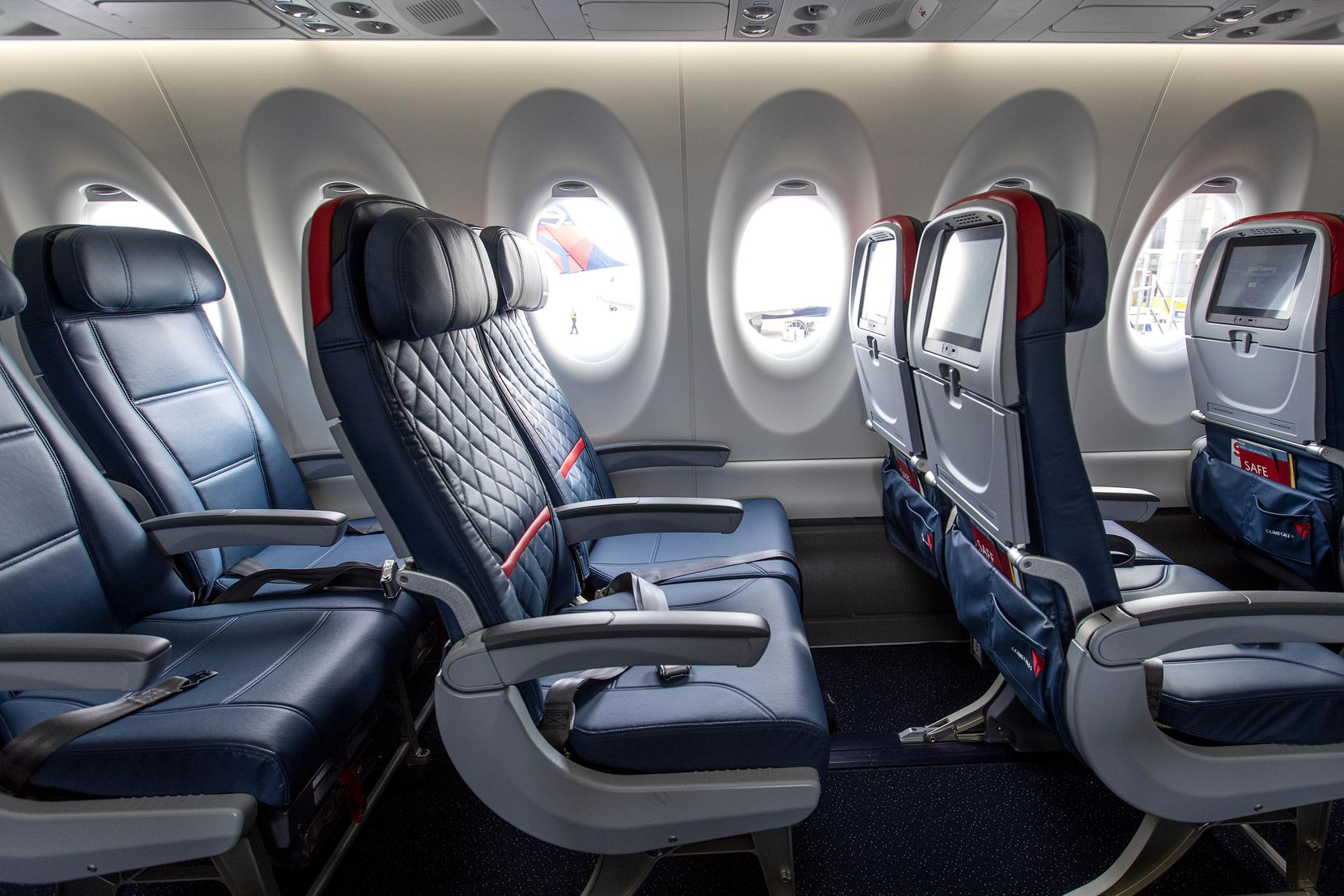 Economy class (left) and Comfort+ (center and right) rows of seating on Delta's new Airbus A220-100 airplane.