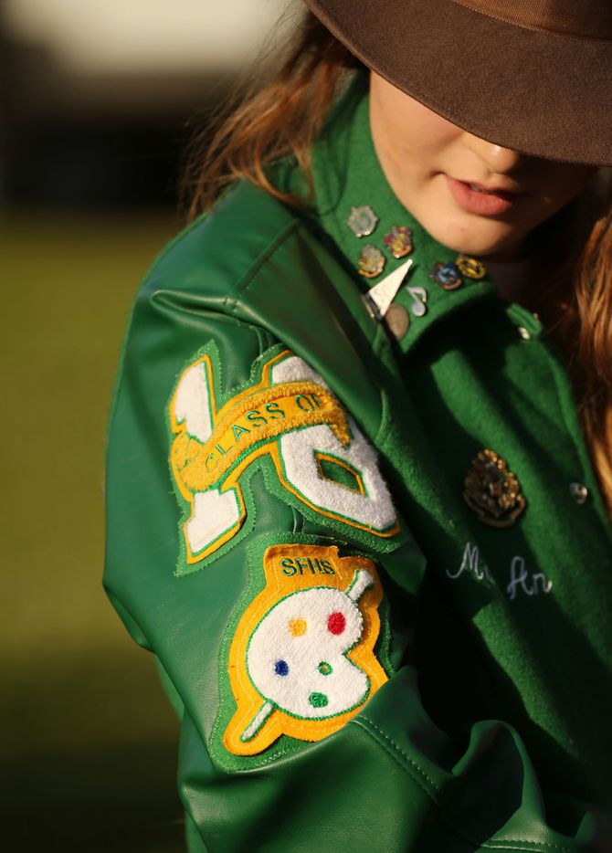 Mary An Fields, who was once in the art program at Santa Fe High School, wore her school jacket to the vigil Friday.