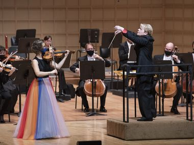 Marin Alsop (right) conducts the Dallas Symphony Orchestra with guest violinist Hilary Hahn as they perform Mozart's Concerto for Violin and Orchestra No. 5 in A Major, at the Morton H. Meyerson Symphony Center in Dallas, on Thursday, Nov. 5.