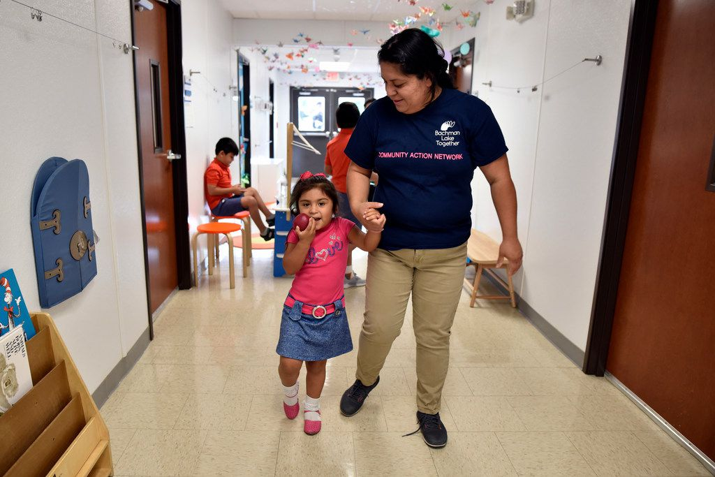Patricia Vega walks with daughter Elizabeth Diaz before working on activities to help her transition to pre-K at the Bachman Lake Together Family Center in Dallas. (Ben Torres/Special Contributor)