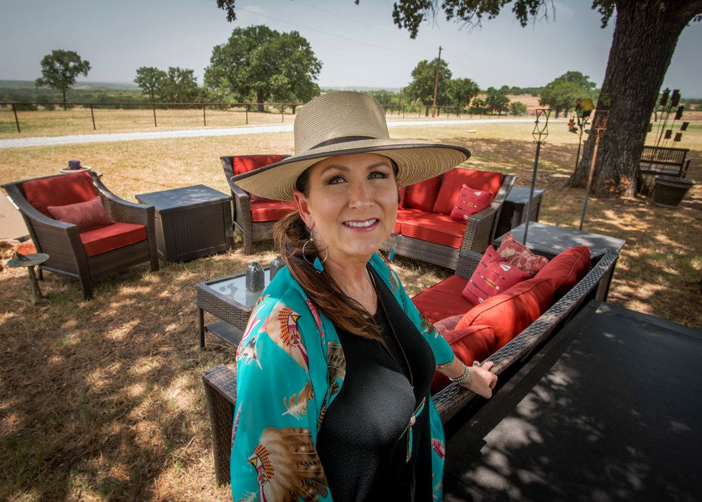 Melanie Newton, wife of Cowboy Chef Mike Newton, in the part of their yard where they entertain guests at their home.