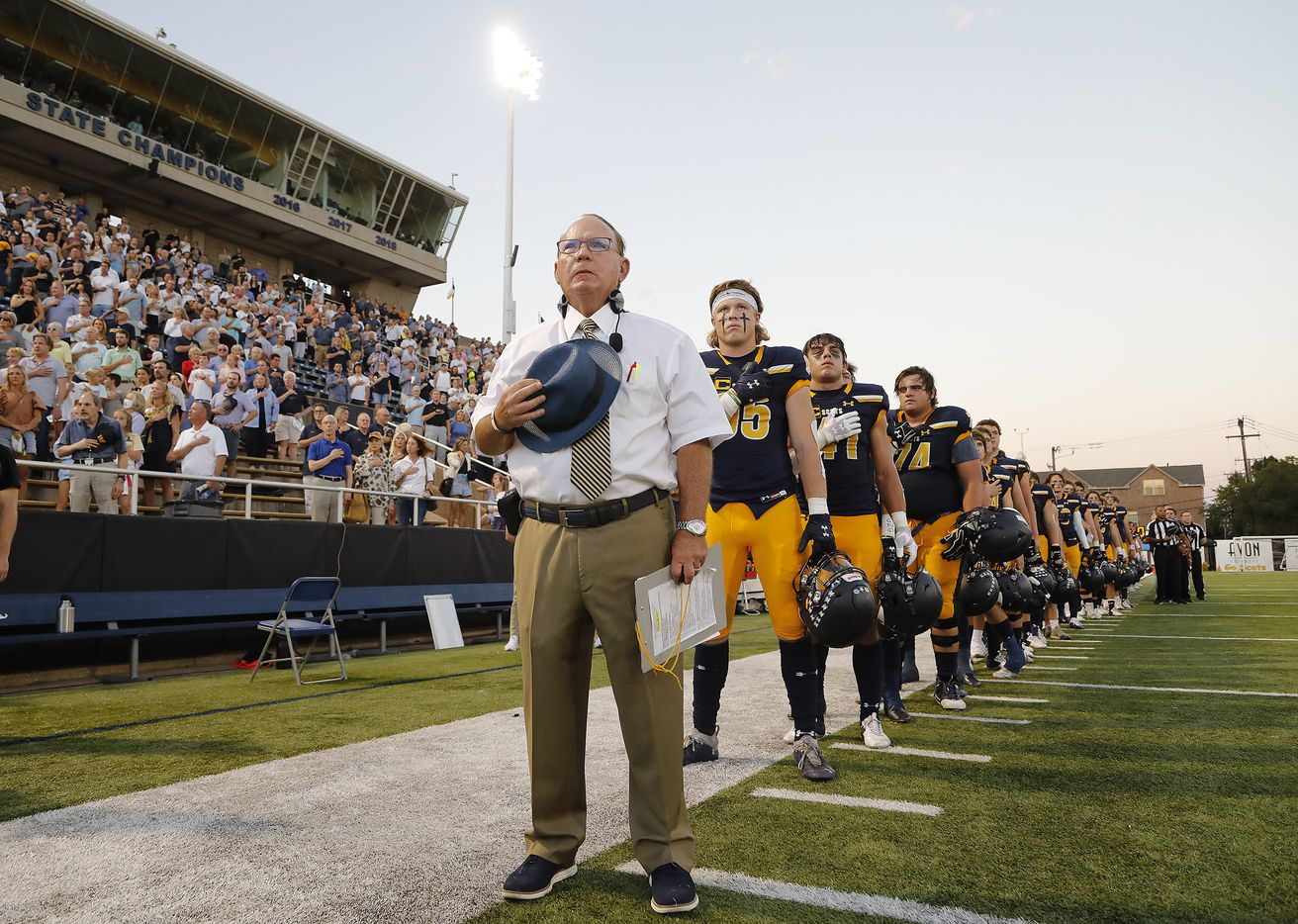 Highland Park High School head coach Randy Allen stands at attention with his team for the national anthem as Highland Park High School hosted Rockwall High School at Highlander Stadium in Dallas on, Friday, September 17, 2021. (Stewart F. House/Special Contributor)