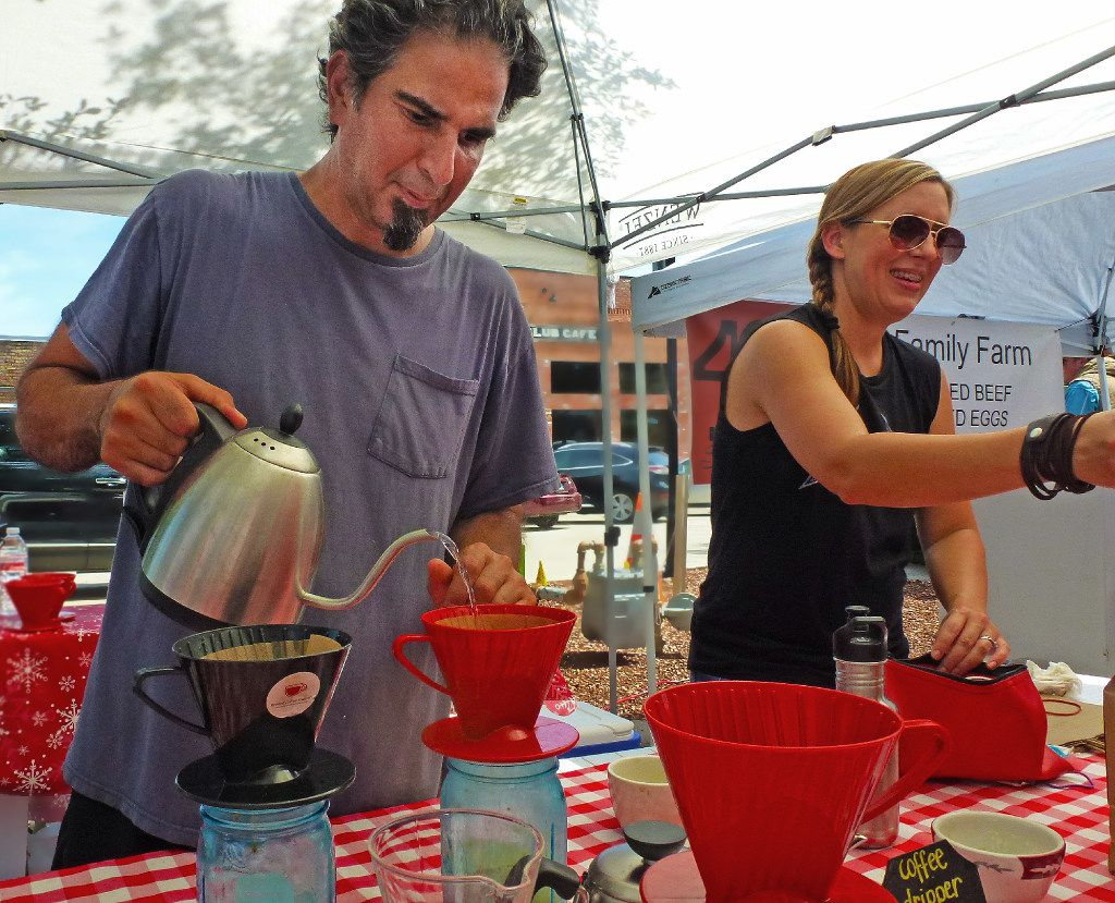 Home-based roaster Drake Tenorio from Rowlett Coffee Roastery shares his love of fresh-roasted  and brewed coffee with Rockwall Farmers Market shoppers. His wife, Aprille, helps him.