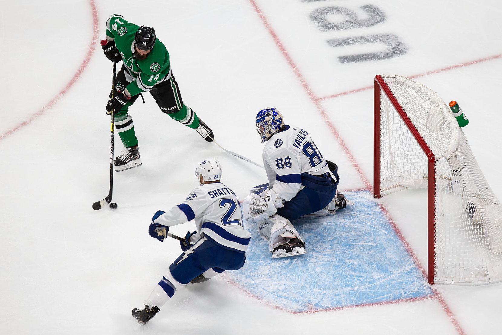 Jamie Benn (14) of the Dallas Stars looks for a shot against goaltender Andrei Vasilevskiy (88) of the Tampa Bay Lightning during Game Three of the Stanley Cup Final at Rogers Place in Edmonton, Alberta, Canada on Wednesday, September 23, 2020. (Codie McLachlan/Special Contributor)