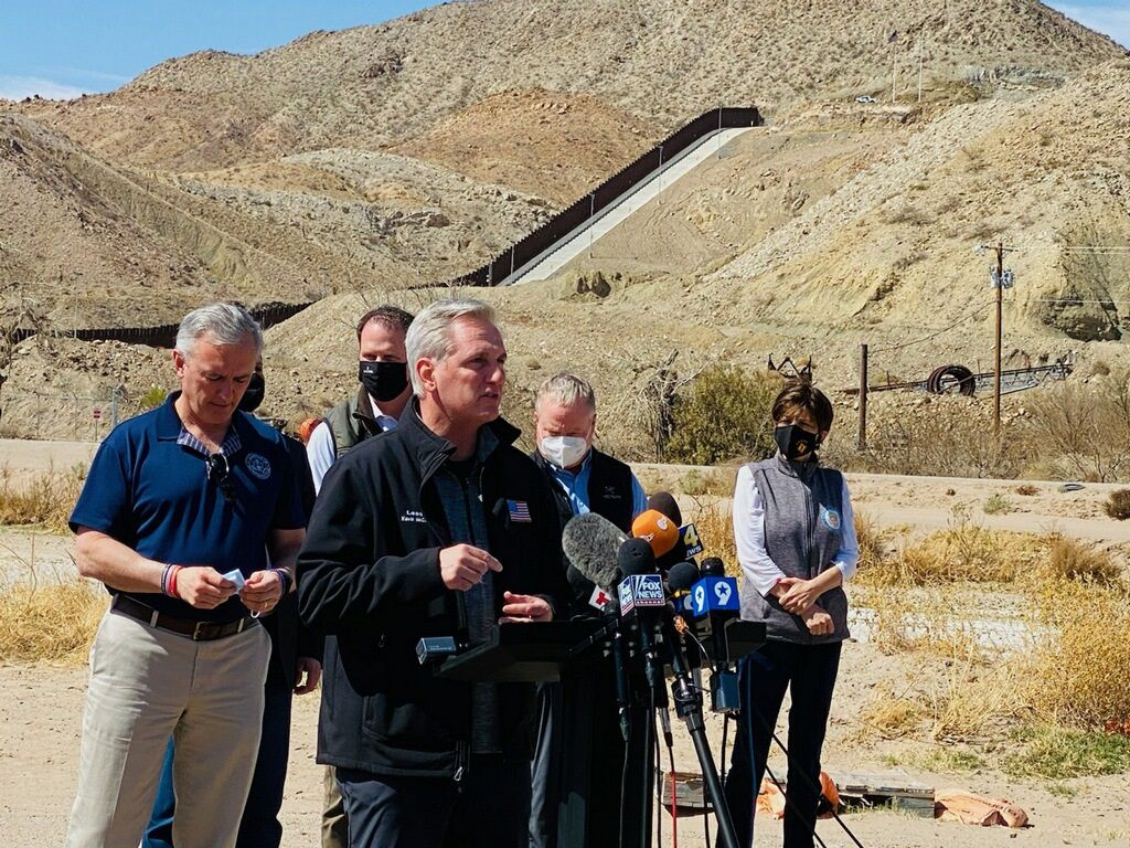 Minority Leader Kevin McCarthy, R-Calif., at microphones, blasted the Biden administration for making the migration crisis worse on a trip to the border Monday, March 15, in El Paso.