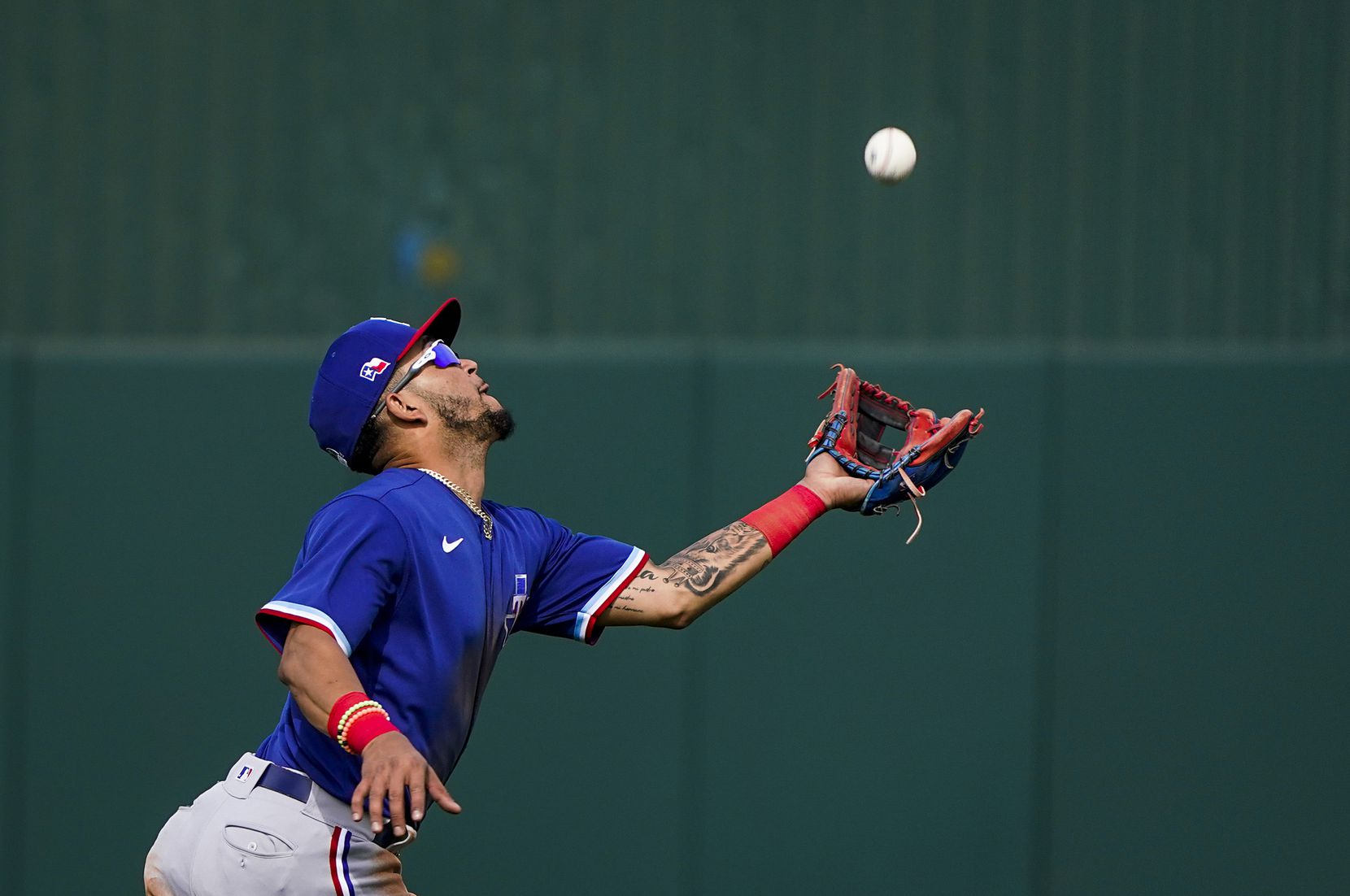Texas Rangers infielder Anderson Tejeda races back to grab a popup off the bat of Los Angeles Angels second baseman Luis Rengifo during the fifth inning of a spring training game at Tempe Diablo Stadium on Friday, Feb. 28, 2020, in Tempe, Ariz.