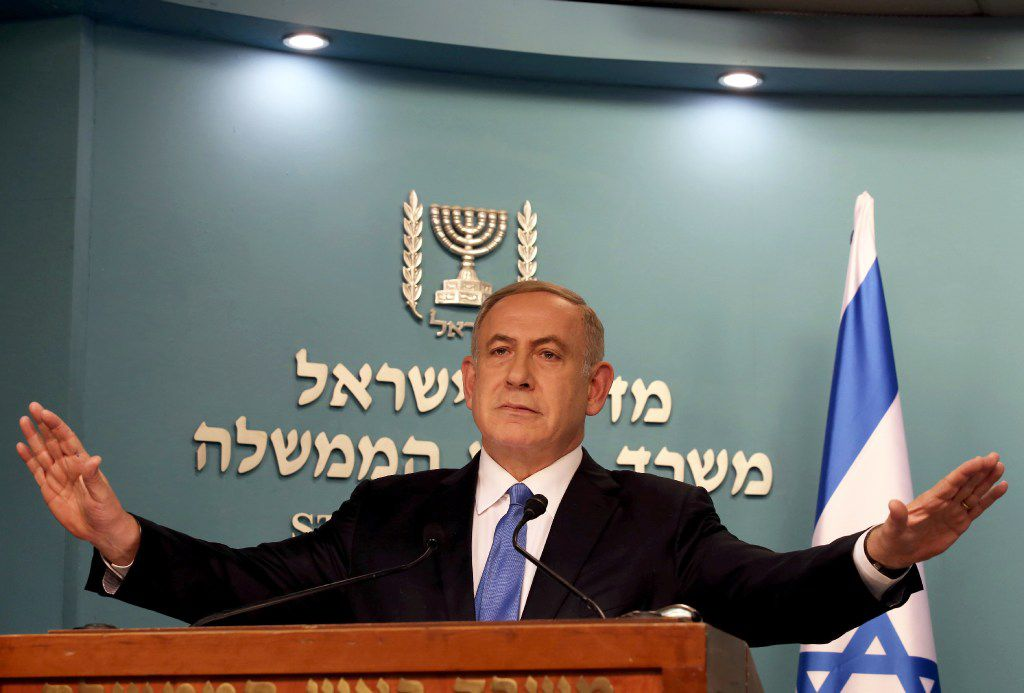 Israeli Prime Minister Benjamin Netanyahu gestures as he delivers a statement to the press at his Jerusalem office on December 28, 2016, in response to a speech by the US Secretary of State.