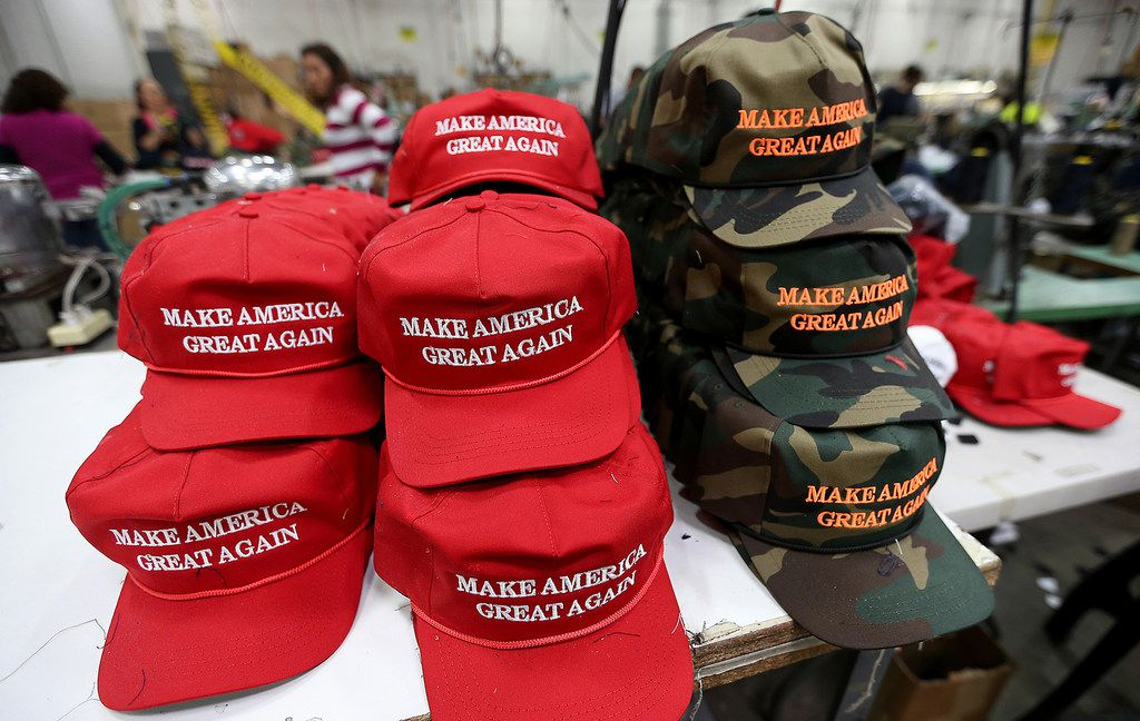 Workers stitch together hats at Cali Fame and Cali Headwear in Carson, Calif. The hat and apparel maker is best known for producing Make America Great Again caps. (Luis Sinco/Los Angeles Times)