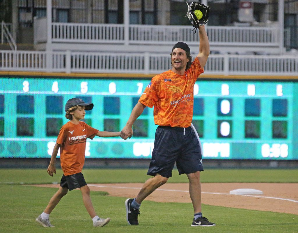 Actor Matthew McConaughey and his son Levi are introduced before the Red River celebrity softball game at the Dr. Pepper Ballpark in Frisco, Texas. (Louis DeLuca/The Dallas Morning News)