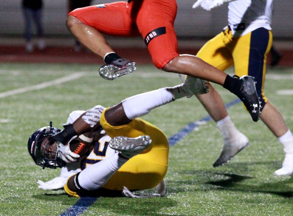 Highland Park defender Prince Dorbah (32) grabs an interception late in the fourth quarter during the fourth quarter of the Highland Park's 66-59 win over Rockwall high at Wilkerson-Sanders Stadium in Rockwall on Friday, August 30, 2019. (John F. Rhodes / Special Contributor)
