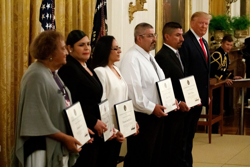 President Donald Trump stood with five civilians receiving Heroic Commendations for actions during the mass shooting in El Paso -- (from left)  Minnie Grant, the mother of Chris Grant;, Angelica Silva;, Marisela Luna, Gilbert Serna; and Robert Evans, in the East Room of the White House on, Sept. 9  ,in Washington.