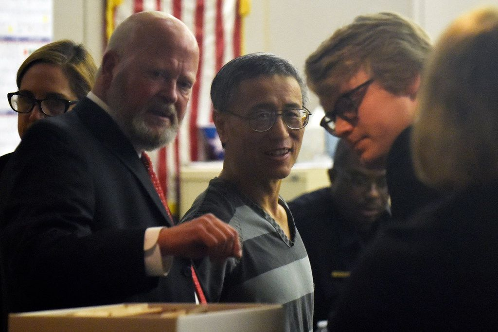 Attorney Brad Lollar, left, with George Guo, right, as Guo walks into the 194th District Court for a hearing at the Frank Crowley Courts Building in Dallas, Friday morning Aug. 02, 2019. Guo will stand trail for the death of a woman who died from injuries she suffered 30 years after being attacked and raped in Highland Park.