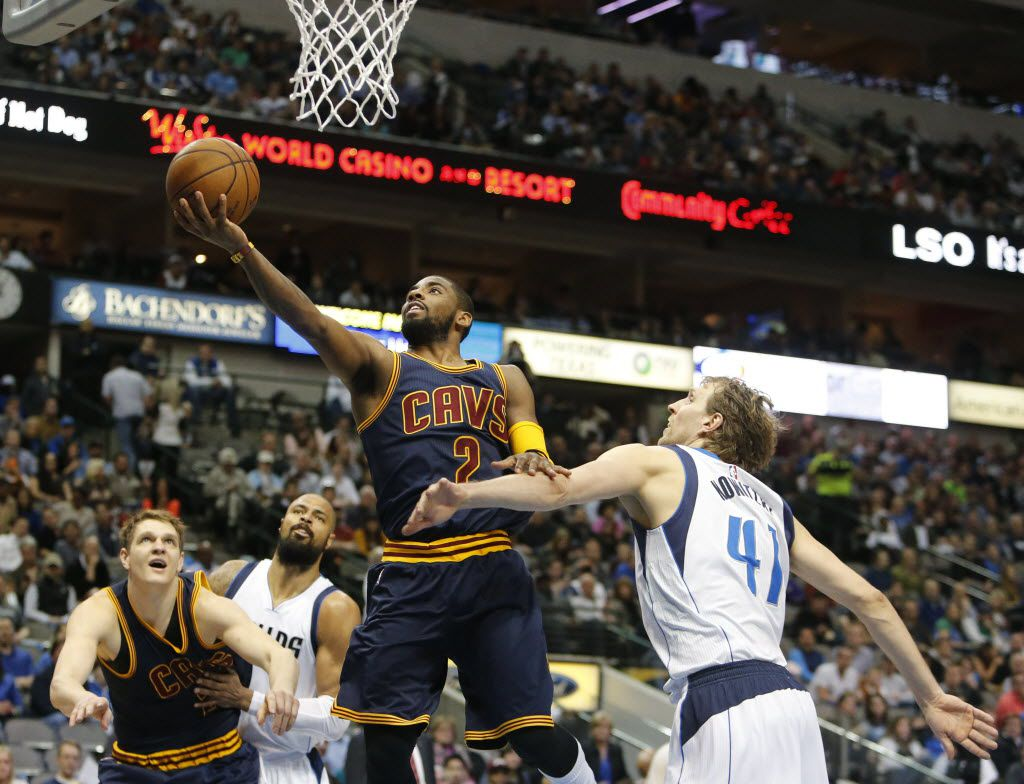 Cavs guard Kyrie Irving drives to the hoop for a layup over Dirk Nowitzki during the second half of the regular season NBA game between the Dallas Mavericks and the Cleveland Cavaliers on Tuesday, March 10, 2015 at the American Airlines Center in Dallas. (Gregory Castillo/The Dallas Morning News)