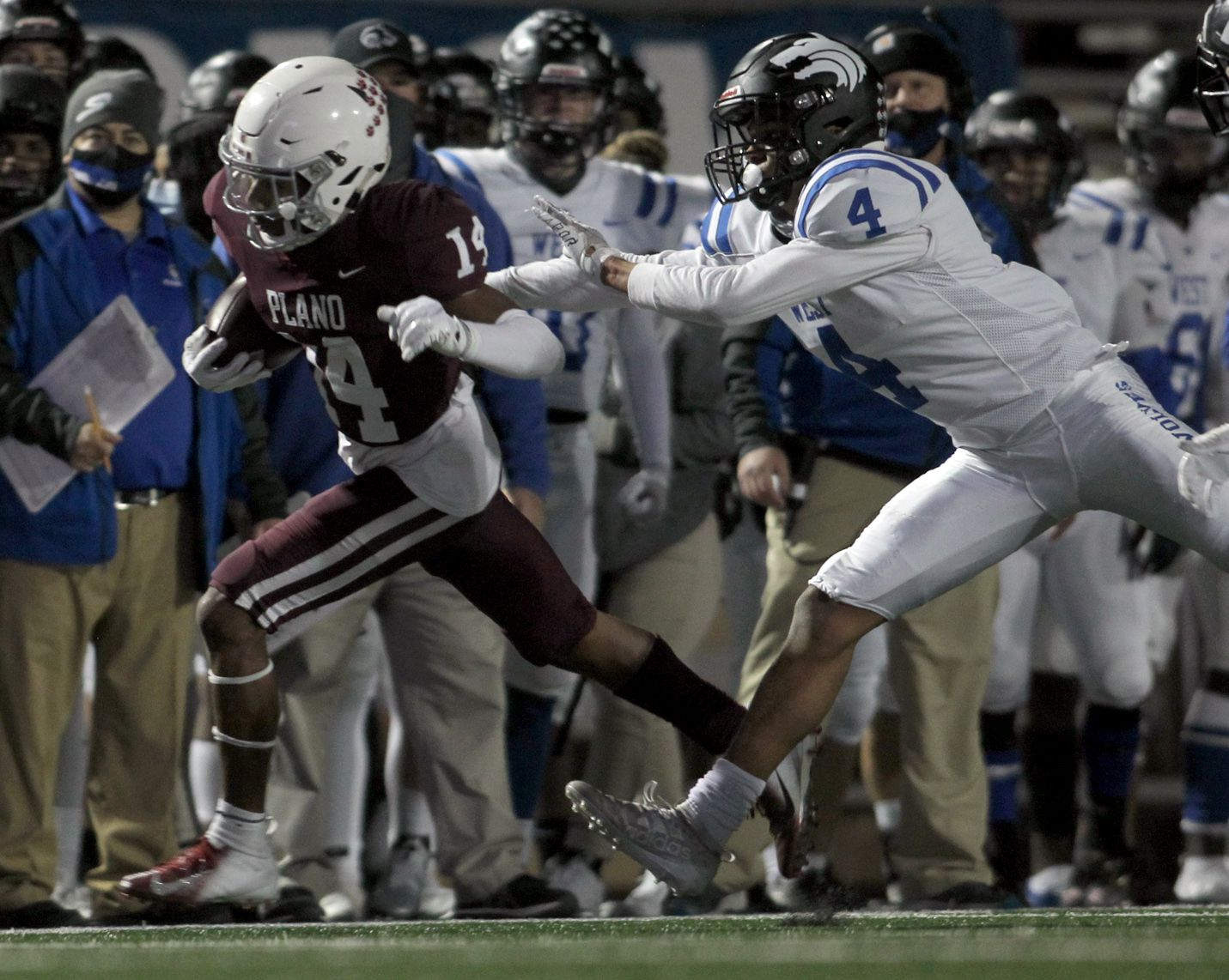 Plano receiver Khamare Spivery (14) is shoved out of bounds by Plano West defensive back Tyler Harrell (4) following a second quarter reception. The two teams played their District 6-6A football game at Clark Stadium in Plano on December 4, 2020. (Steve Hamm/ Special Contributor)