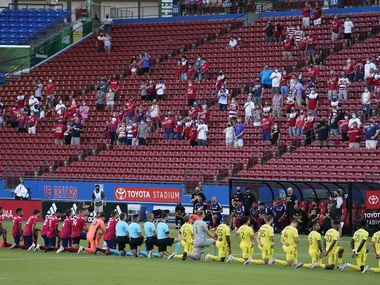 FC Dallas (left) and Nashville SC players kneel during the national anthem before an MLS soccer game at Toyota Stadium on Wednesday, Aug. 12, 2020, in Frisco, Texas.