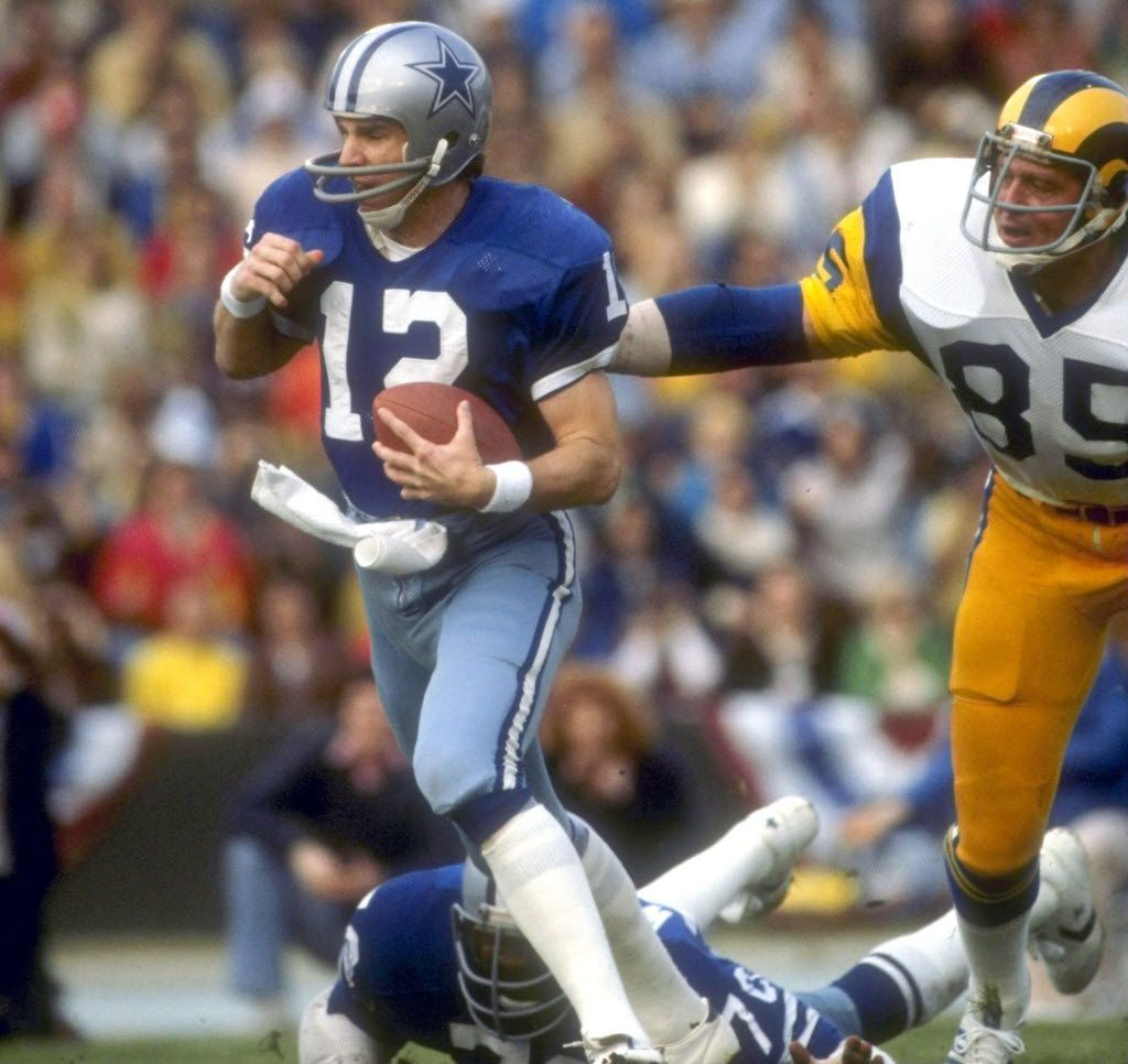 Cowboys quarterback Roger Staubach scrambles from the pocket during a playoff game against the Rams in January 1979 at the L.A. Memorial Coliseum in Los Angeles.