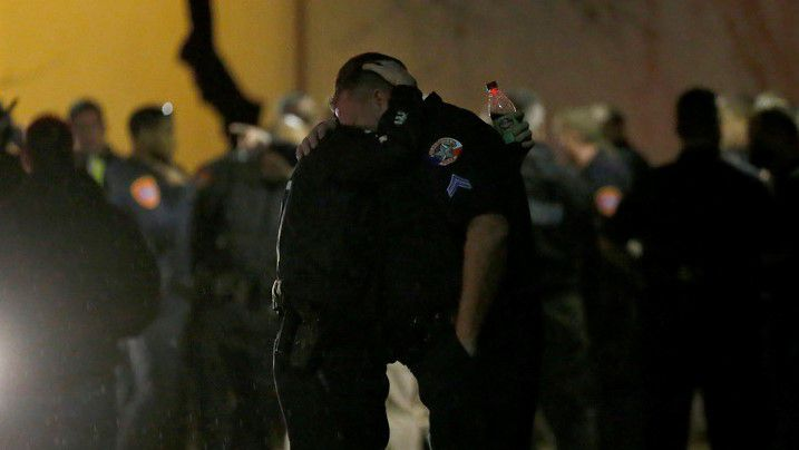 Police officers console each other outside the emergency room at Medical City Denton. (Jae S. Lee/Staff Photographer)