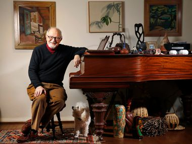 Rick Brettell, art critic of The Dallas Morning News, is photographed at his Dallas home on Dec. 5, 2018. Brettell, sitting next to his miniature poodle Laney, is founding director of the Edith O'Donnell Institute of Art History at the University of Texas at Dallas and a former director of the Dallas Museum of Art.