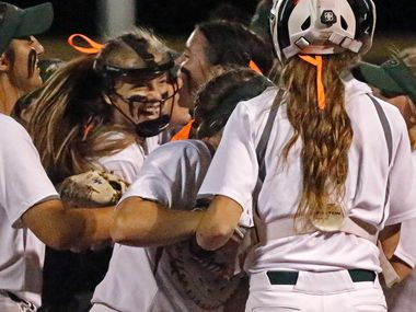 Prosper pitcher Elissa Griffin (16) is mobbed by teammates after winning their series as Prosper High School hosted Ft. Worth Boswell High School in game two of a best of three series 6A Region I semifinal softball game in Prosper on Thursday night, May 20, 2021.