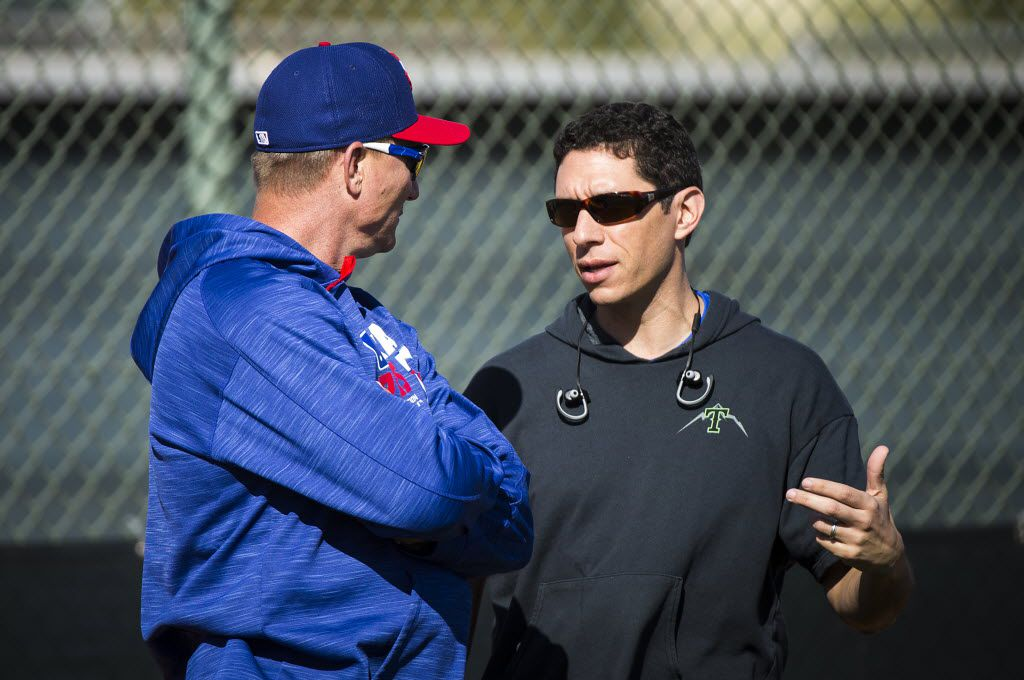 Texas Rangers General Manager Jon Daniels (left) and manager Jeff Banister watch pitchers run a fielding drill during a spring training workout at the team's training facility on Tuesday, Feb. 23, 2016, in Surprise, Ariz. (Smiley N. Pool/The Dallas Morning News)
