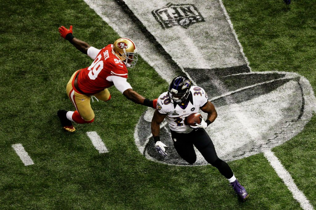 NEW ORLEANS, LA - FEBRUARY 03:  Bernard Pierce #30 of the Baltimore Ravens runs with the ball in the second half against Aldon Smith #99 of the San Francisco 49ers during Super Bowl XLVII at the Mercedes-Benz Superdome on February 3, 2013 in New Orleans, Louisiana.  (Photo by Rob Carr/Getty Images)