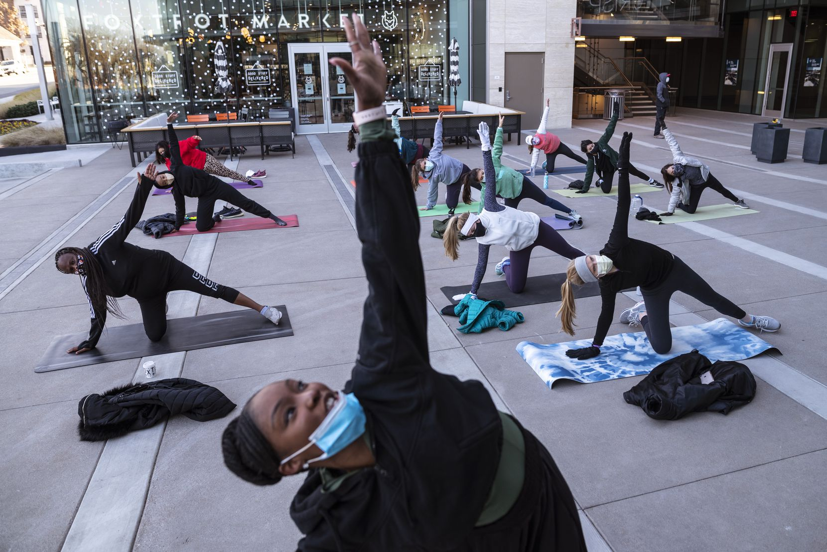 Pilates instructor Jasmine White, center, conducts a fitness class outside of Crisp & Green restaurant in Dallas on Saturday, January 9, 2021.