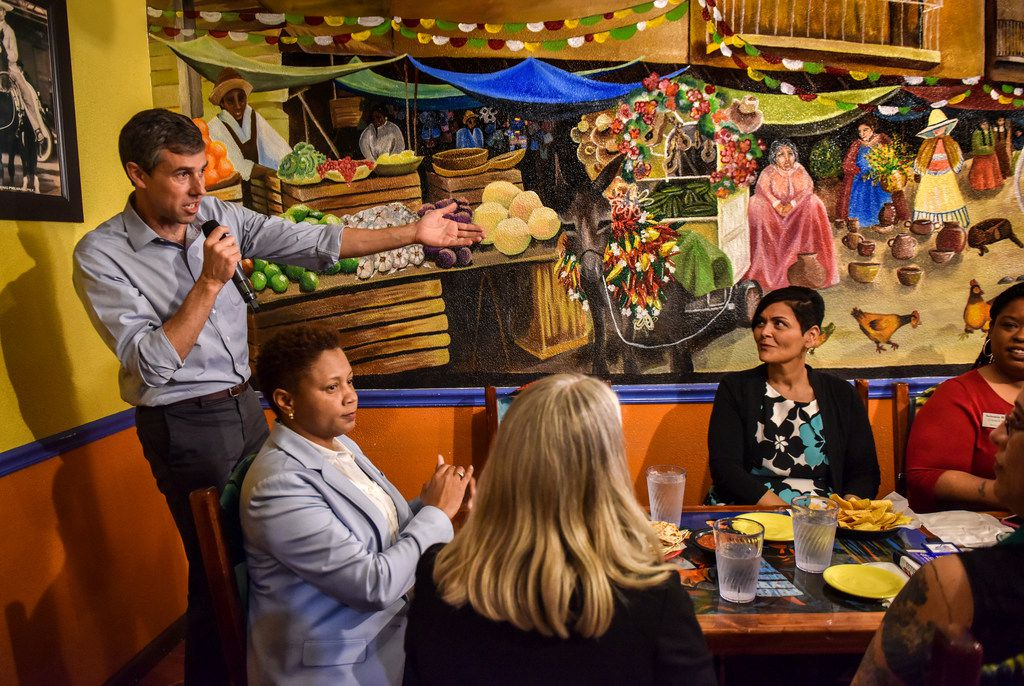 Presidential candidate Beto O'Rourke participates in a round table with local politicians at a Mexican restaurant in Dumfries, Va.