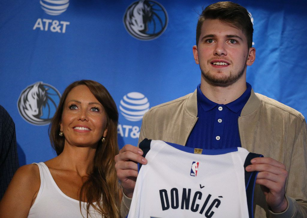 Mirjam Poterbin stands with her son new Dallas Mavericks player Luka Doncic after he is introduced at the American Airlines Center in Dallas Friday June 22, 2018. Doncic was drafted by the Atlanta Hawks with the third overall pick of the 2018 National Basketball Association draft and traded for the Dallas Mavericks fifth overall draft pick Trae Young. (Andy Jacobsohn/The Dallas Morning News)