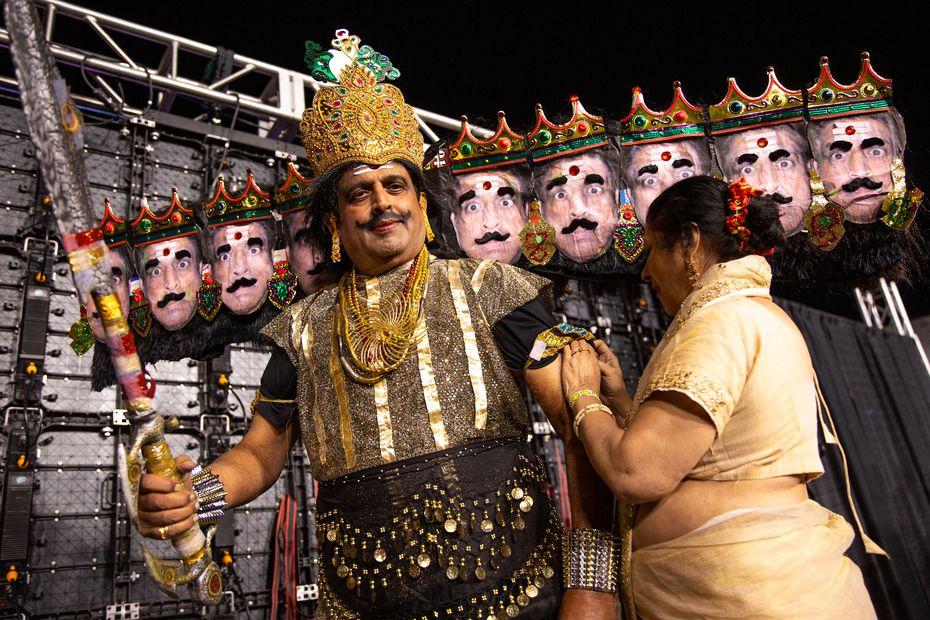 Mangala Kagal helps Dr. Prakash Kagal straighten his Ravana costume, a 10-headed demon portrayed in Ramlila.