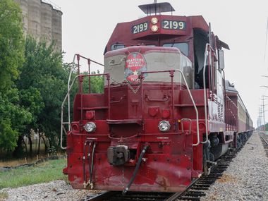 """The 1953 diesel locomotive, """"Vinny,""""  of the Grapevine Vintage Railroad prepares to depart downtown Grapevine on Friday June 2, 2017. (Ron Baselice/The Dallas Morning News)"""