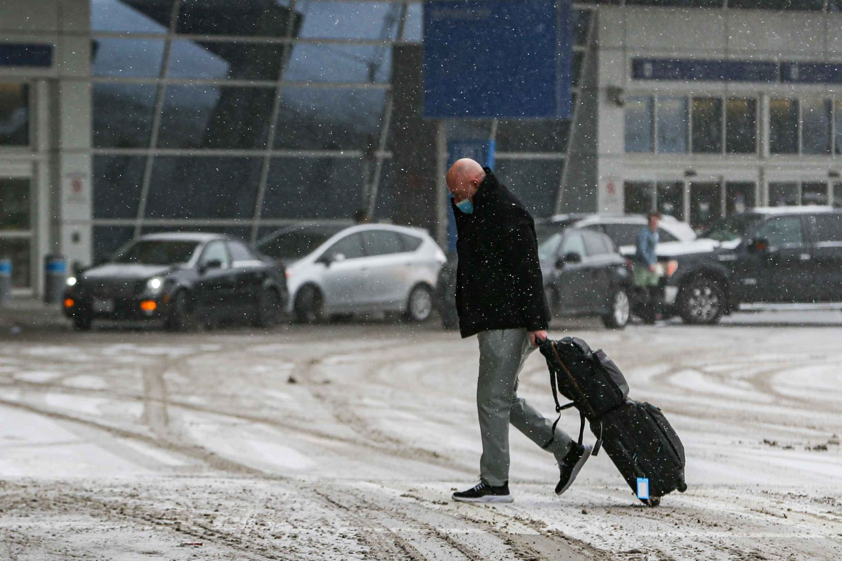 Snow, ice decend over DFW International Airport as American cancel hundreds of flights in Irving on Sunday, February 14, 2021.