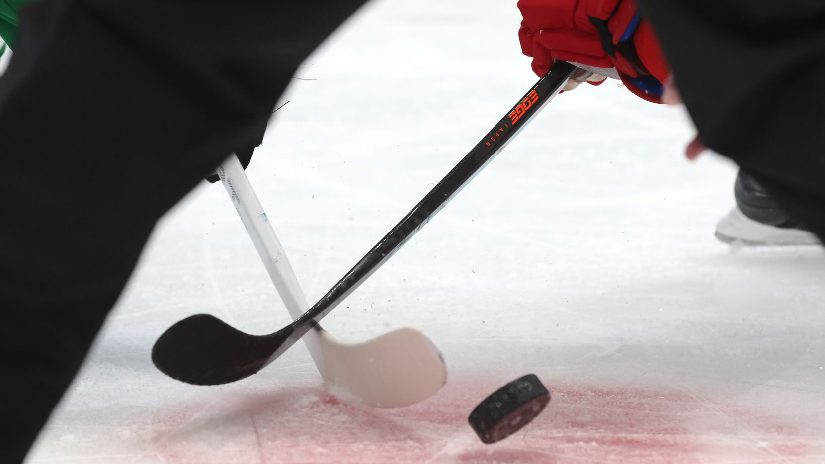 Players go after the puck during a faceoff in the first period of play between the Detroit Red Wings and Dallas Stars at American Airlines Center on Tuesday, January 26, 2021 in Dallas.