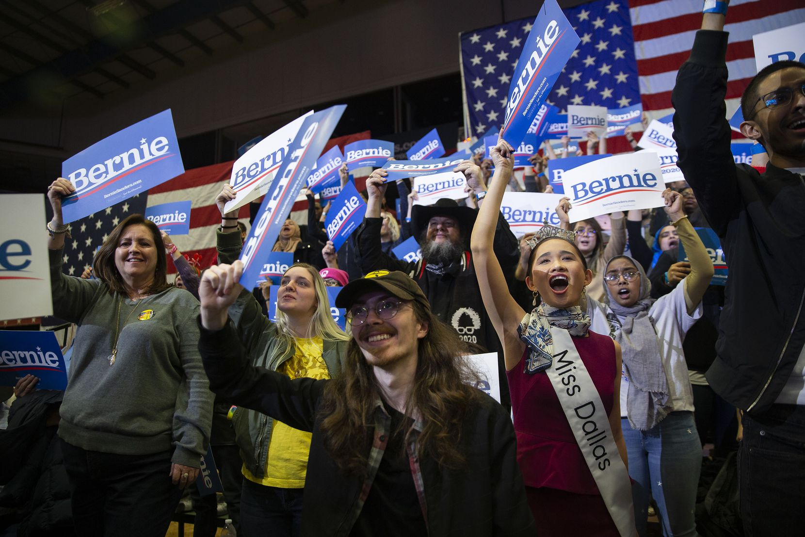 Fans -- including SMU law student Averie Bishop, right, who is Miss Dallas 2020 -- cheer as Democratic presidential candidate Bernie Sanders, I-Vt., holds a Valentine's Day rally at the Mesquite Arena on Feb. 14, 2020 in Mesquite, Texas.