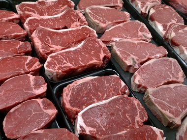 File photo of steaks and other beef products at the supermarket. Based on wholesale prices, meat prices may continue to be higher this summer.