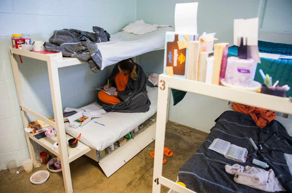 Inmate Beth Wesner, 25, sketches on her bunk at the Burnet County Jail in October. The jail had one of the most significant increases in female inmates in Texas, largely because it houses women for other counties that have run out of room.