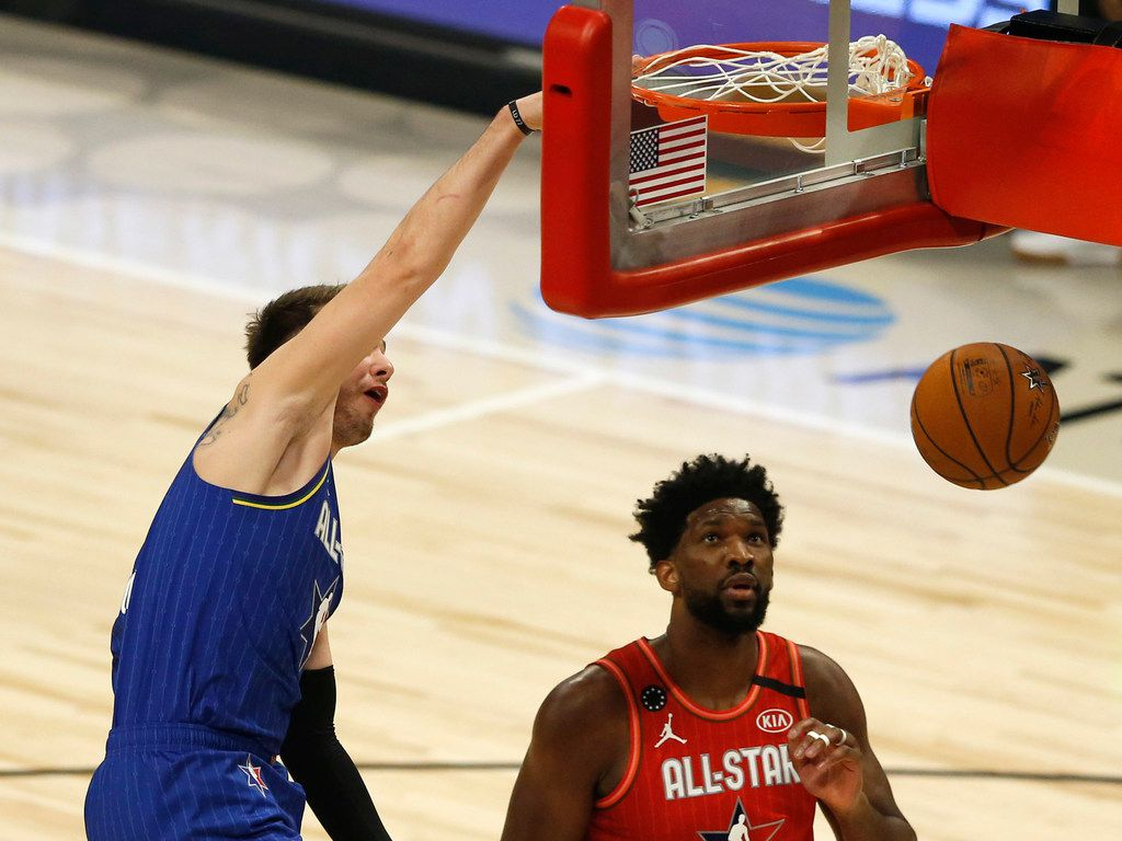 Team LeBron's Luka Doncic (2) dunks the ball in front of Team Giannis's Joel Embid (24) during the first half of play in the NBA All-Star 2020 game at United Center in Chicago on Sunday, February 16, 2020. (Vernon Bryant/The Dallas Morning News)