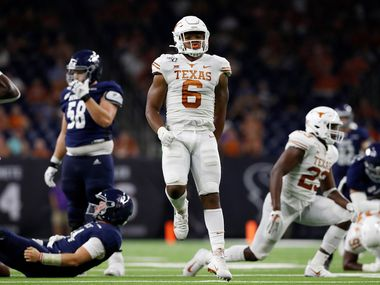 FILE - Texas linebacker Juwan Mitchell (6) celebrates after sacking Rice quarterback Tom Stewart (14) in the second half of a game at NRG Stadium on Sept. 14, 2019, in Houston. (Photo by Tim Warner/Getty Images)