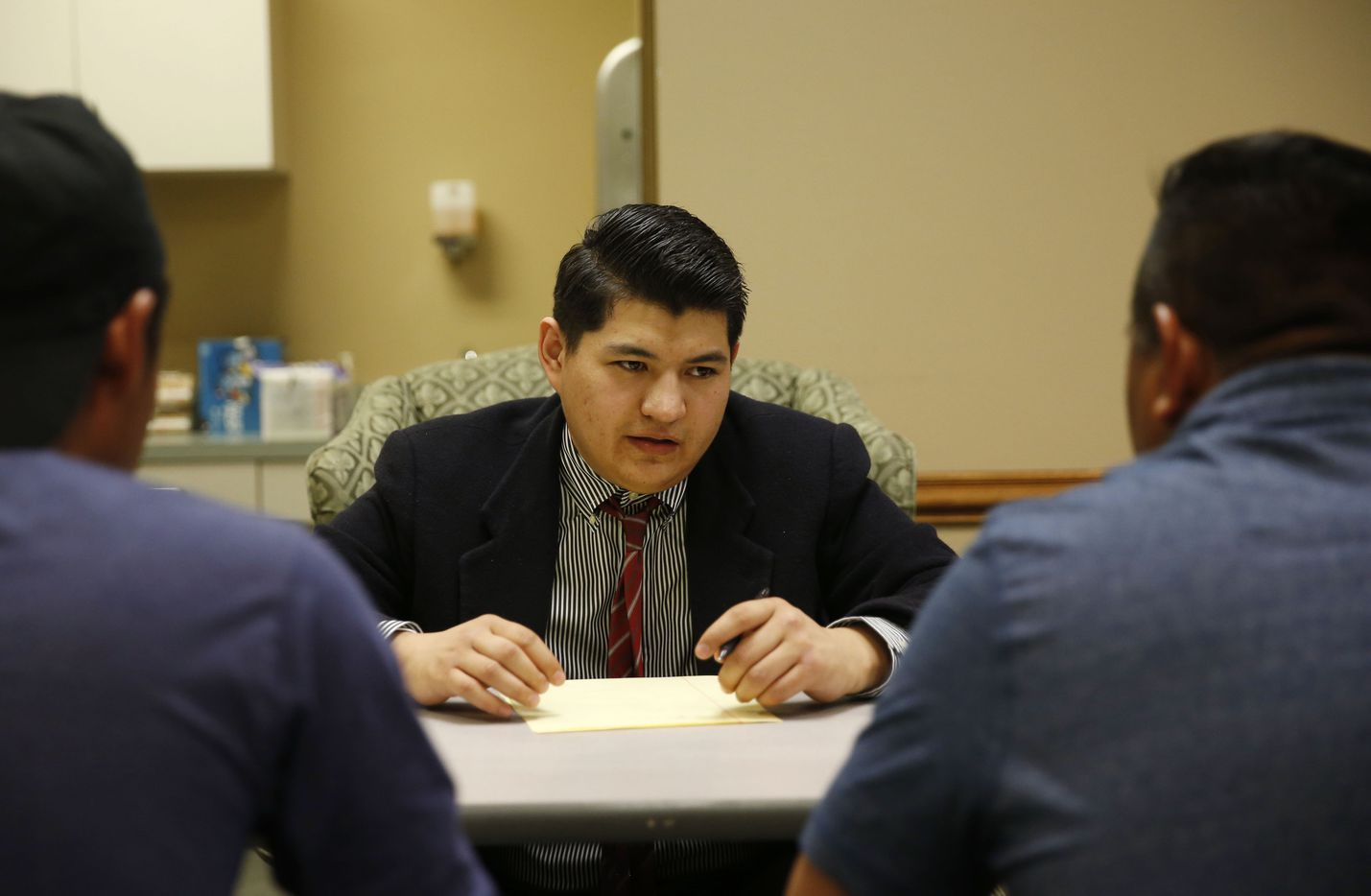 Attorney, Pablo Acosta of Richardson gives legal advice to a family at First United Methodist Church Allen on Wednesday, April 3, 2019 in Allen, Texas. A group of attorneys volunteered their time to give free legal advice to people affected by the ICE raid at CVE in the morning. (Vernon Bryant/The Dallas Morning News)
