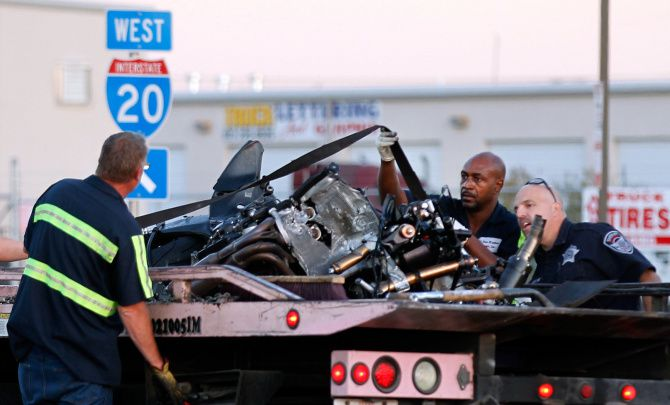 Wreckers tied down a motorcycle to be hauled away after a fatal 2011 accident on I-20 near Bonnie View Road.