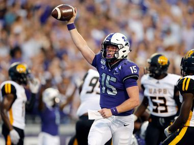TCU Horned Frogs quarterback Max Duggan (15) ducked under a defender and ran in a first quarter touchdown against the Arkansas-Pine Bluff Golden Lions  at Amon G. Carter Stadium in Fort Worth Texas, Saturday, August 31, 2019.