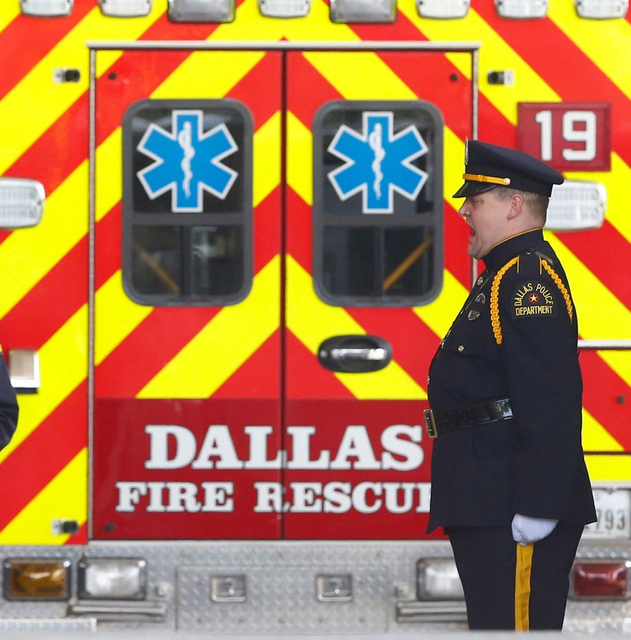 A member of the Dallas Police honor guard calls out order at Baylor University Medical Center at Dallas on Saturday.